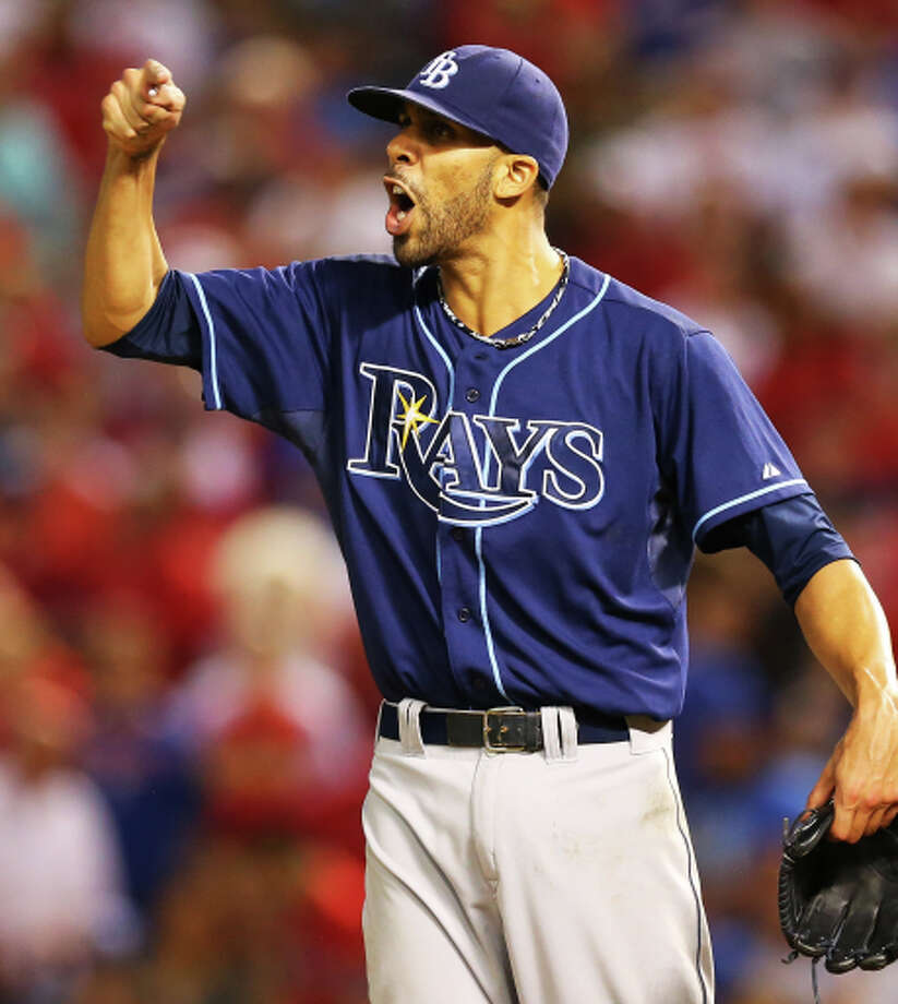 ARLINGTON, TX - SEPTEMBER 30:  David Price #14 of the Tampa Bay Rays reacts against the Texas Rangers in the American League Wild Card tiebreaker game at Rangers Ballpark in Arlington on September 30, 2013 in Arlington, Texas.  (Photo by Ronald Martinez/Getty Images) Photo: Ronald Martinez / Getty Images / 2013 Getty Images