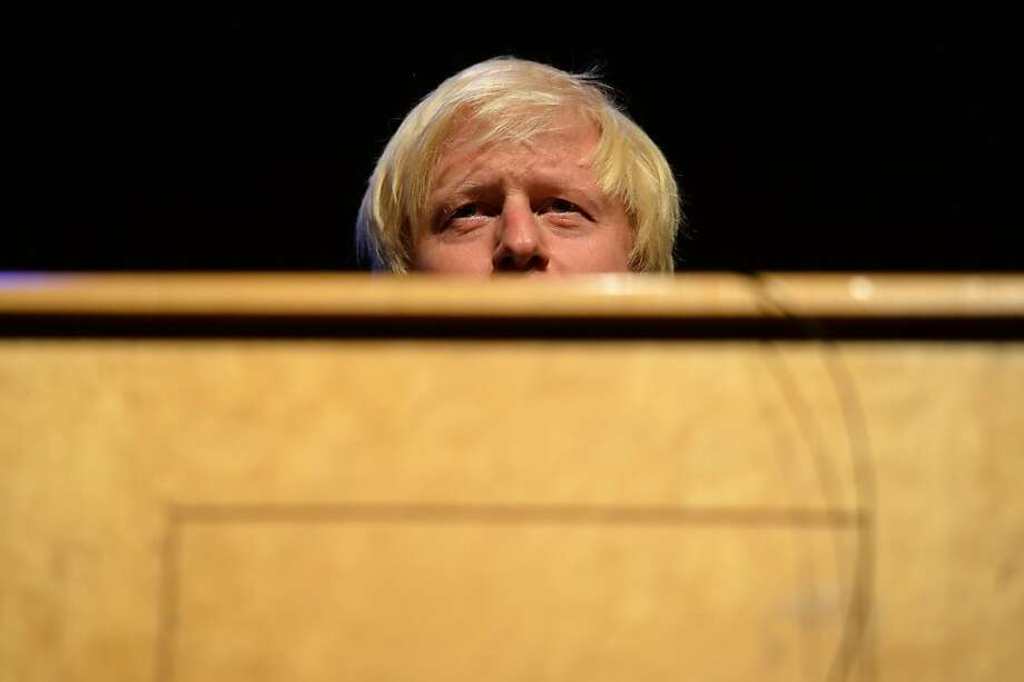 London Mayor Boris Johnson speaks at a fringe event running in conjuction with the Conservative Party conference in Manchester, northwest England on September 30, 2013.  Britons who are out of work for several years will be forced to carry out community work to receive state unemployment payments, finance minister George Osborne announced speaking at the annual party conference. TOPSHOTS/AFP PHOTO / LEON NEALLEON NEAL/AFP/Getty Images Photo: Leon Neal, AFP/Getty Images