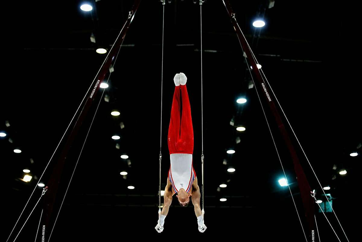 ANTWERPEN, BELGIUM - SEPTEMBER 30: Max Whitlock of Great Britain competes in the Rings Qualification on Day One of the Artistic Gymnastics World Championships Belgium 2013 held at the Antwerp Sports Palace on September 30, 2013 in Antwerpen, Belgium. (Photo by Dean Mouhtaropoulos/Getty Images) *** BESTPIX ***