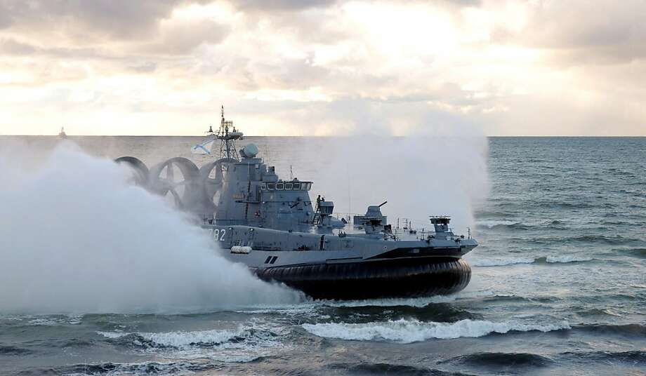 TOPSHOTS A picture taken on September 26, 2013, shows a Russian Navy Zubr class hovercraft lands on the seashore during a joint military exercises of Russian and Belarus troops at the Khmelevka firing range in the Russia's enclave of Kaliningrad. AFP PHOTO/ RIA-NOVOSTI/ POOL /ALEXEY DRUZHININALEXEY DRUZHININ/AFP/Getty Images Photo: Alexey Druzhinin, AFP/Getty Images