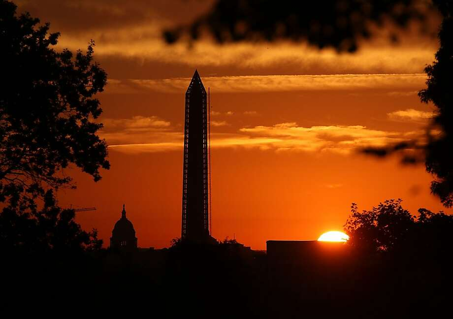 WASHINGTON, DC - SEPTEMBER 30:  The sun begins to rise behind the U.S. Capitol and The Washington Monument, September 30, 2013 in Washington, DC. Negotiation's are ongoing in Congress between the House and Senate about funding the government to avoid a shutdown at midnight on October 1.  (Photo by Mark Wilson/Getty Images) Photo: Mark Wilson, Getty Images