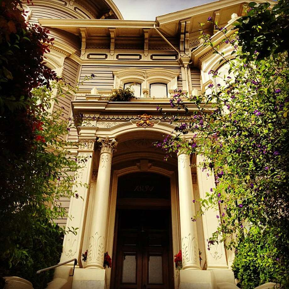 "Zahid Zaman, who lives in the Tenderloin, took this photo in Pacific Heights en-route to the dog run in Lafayette Park. He writes, ""I happened to look up the stairs while walking by and was immediately captivated by the beauty of the half-hidden elegant entrance-way."""