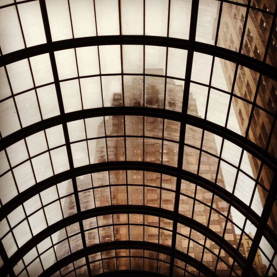 "Sherylrose Iledan, who Instagrams as @shortstack410, took this shot at the Crocker Galleria. She writes: ""You see this amazing architecture of dome-like glass and it always looks pretty when its raining."""