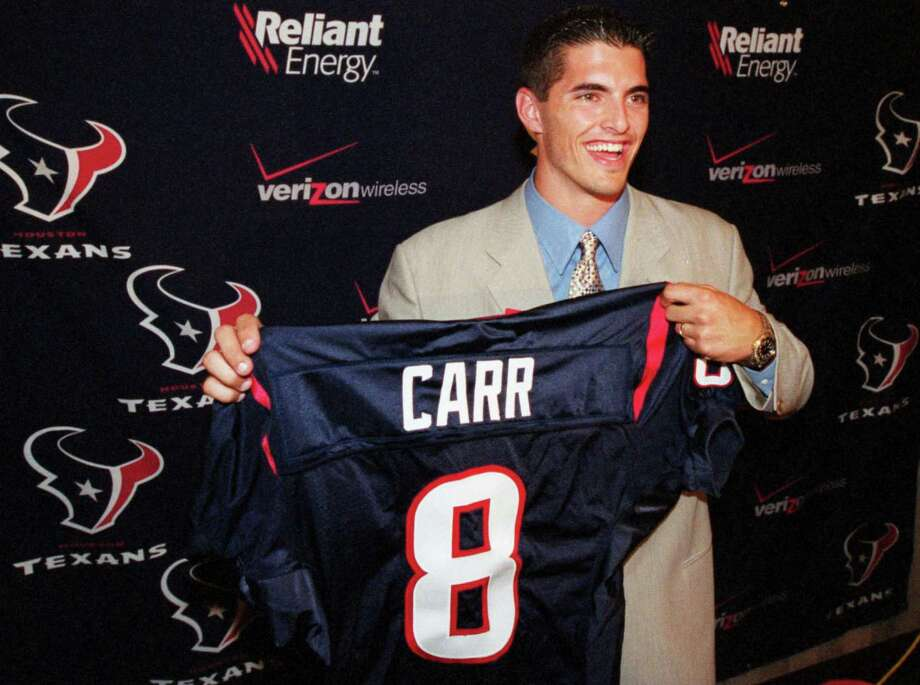 Fresno State quarterback David Carr shows off his Houston Texans jersey at a press conference introducing him as the expansion Texans' No. 1 overall draft pick on April 20, 2002. Photo: Smiley N. Pool, Houston Chronicle / Houston Chronicle