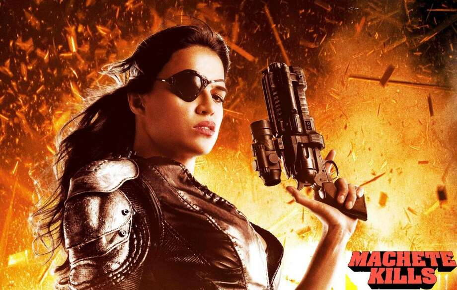 """S.A. native Michelle Rodriguez's beauty and passion define her roles on the big screen. When she was only a child, the Bexar native was relocated to the Caribbean and then the U.S. northeast. The hard-working actress has played  the bad-ass in movies such as """"Girlfight""""  -- she actually trained in a gym  as a boxer -- """"Fast and Furious,"""" """"Resident Evil,"""" and of course """"Machete."""" Photo: Open Road Films"""