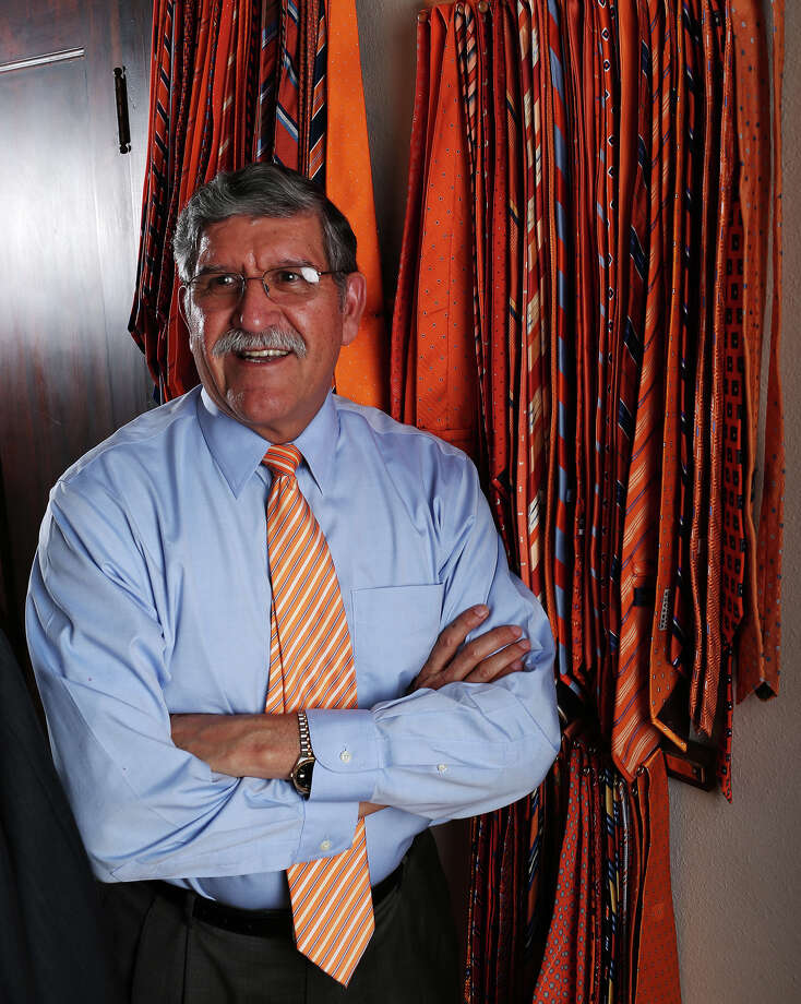 UTSA President Ricardo Romo shows off his hundreds of ties in the university's colors. Photo: JERRY LARA, San Antonio Express-News / © 2013 San Antonio Express-News