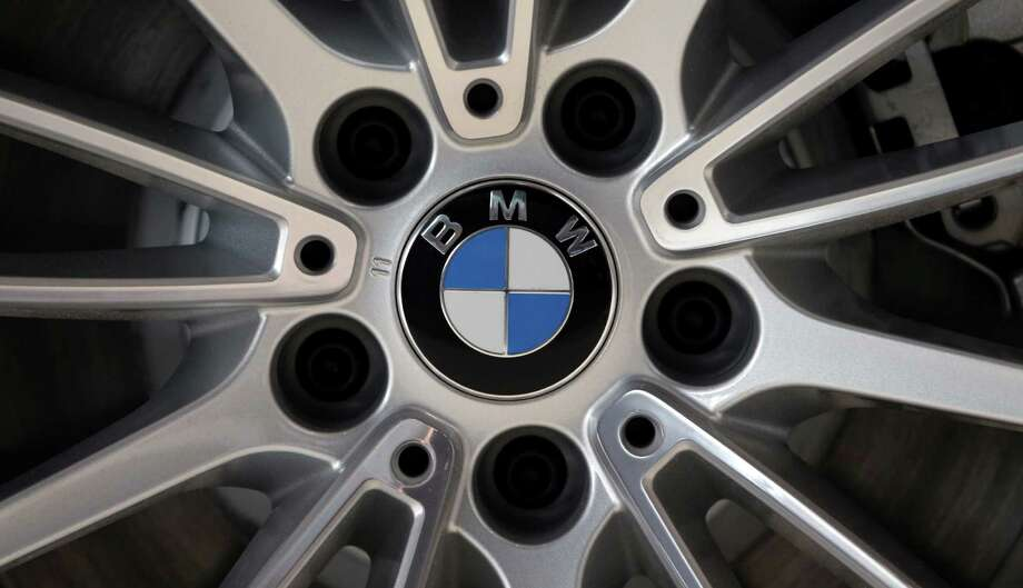 FILE - In this March 19, 2013 file photo, the company logo of car manufacturer BMW is seen on a wheel rim in Munich, Germany. German carmaker BMW is recalling 176,000 vehicles from the model years 2012 to 2014 over a problem with the power brake system. (AP Photo/Matthias Schrader, File) ORG XMIT: LON103 Photo: Matthias Schrader / AP