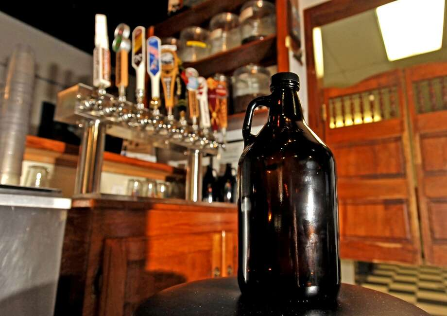 The Logon Cafe is now offering ten new craft beer taps to work with their growler service.  The 64 ounce growler is a great way to take home some fresh brew from a local brewery or brewpub. Photo taken Friday, September 13, 2013. Photo taken: Randy Edwards/The Enterprise Photo: Beaumont Enterprise