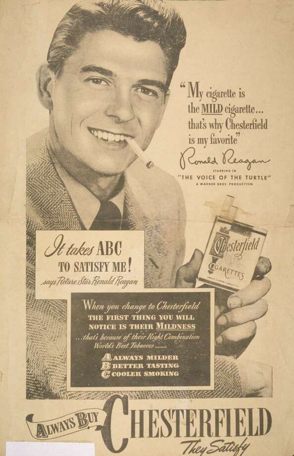Movie actor and future President Ronald Reagan holds a pack of cigarettes and smokes as he appears in a print advertisement for the Chesterfield brand of cigarettes, late 1940s. Text includes: 'My cigarette is the mild cigarette...that's why Chesterfield is my favorite' and 'It takes ABC to satisfy me! says picture star Ronald Reagan.'  Photo: Blank Archives, Getty Images / 2007 Getty Images
