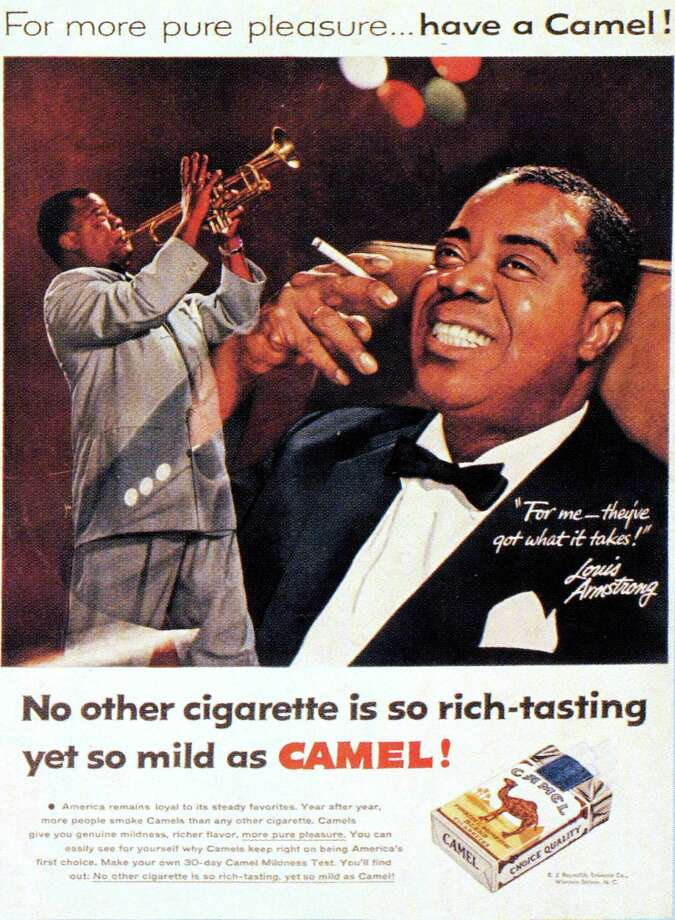 Louis Armstrong advertisement for Camel cigarettes, circa 1970. Photo: GAB Archive, Getty Images / Redferns