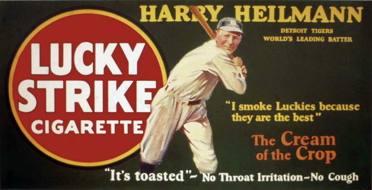 Hall of Famer Harry Heilmann is the baseball star selling Lucky Strike cigarettes on a trolley car sign, circa 1920.
