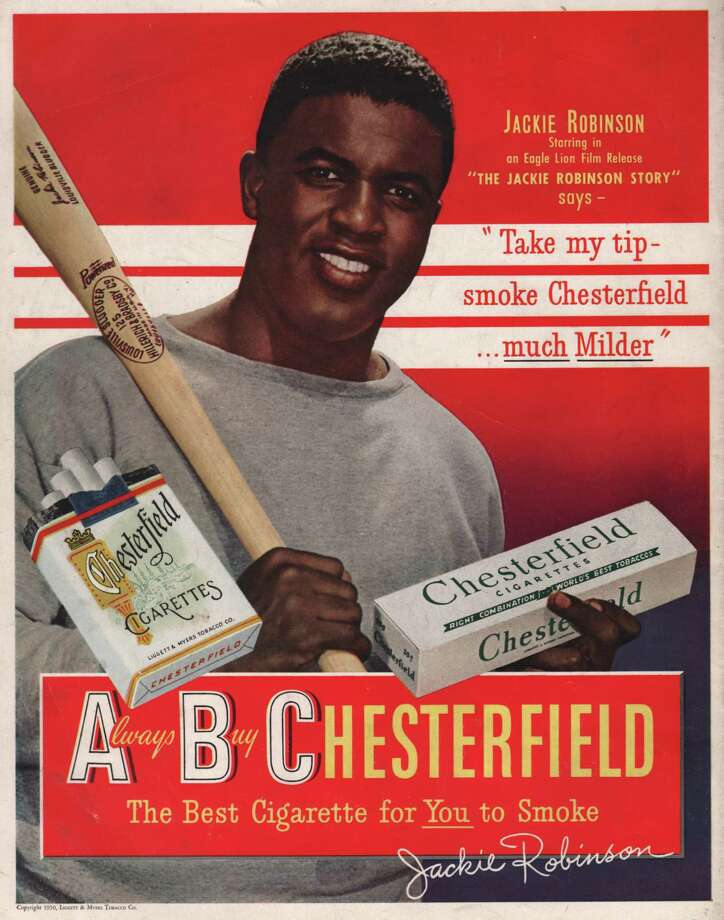 Jackie Robinson endorses Chesterfield in this cigarette ad produced in New York City, circa 1948.  Photo: Transcendental Graphics, Getty Images / 1948 Transcendental Graphics