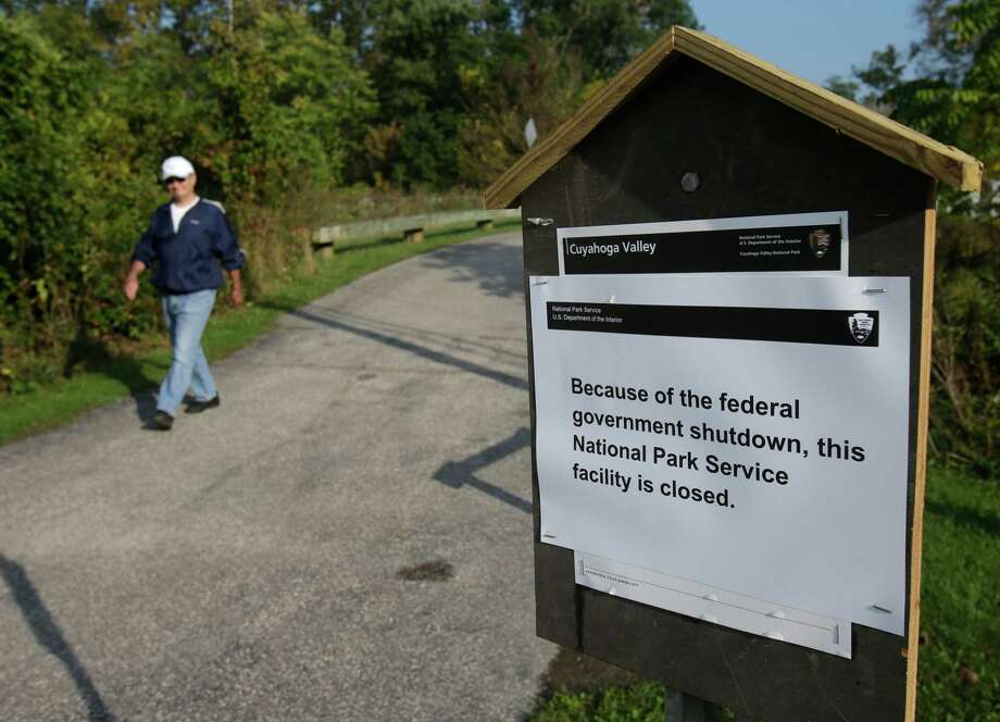 John Carano, 65, walks on a trail at the Cuyahoga Valley National Park on Tuesday, Oct. 1, 2013, in Valley View, Ohio. The impacts of the federal shutdown began rippling across Ohio on Tuesday morning, with a national military museum and national park closing and thousands of federal employees going on furlough. Photo: Tony Dejak