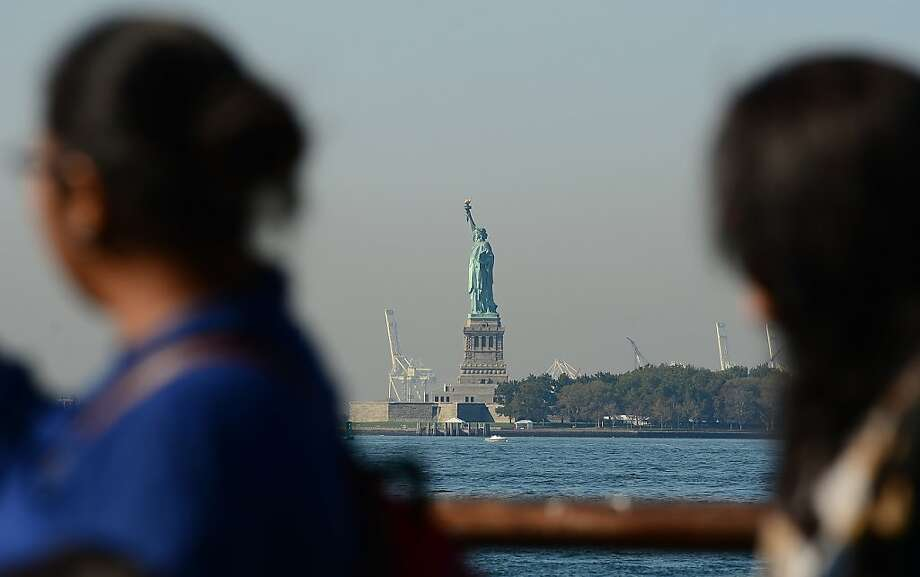 The Statue of Liberty stands empty of visitors after it closed due to an US government shutdown in New York, October 1, 2013. Government institutions and national parks around the US were closed and thousands of employees were furloughed after Congress was unable to agree on a federal budget and shut down the goverment for the first time in 17 years. Photo: Emmanuel Dunand, AFP/Getty Images