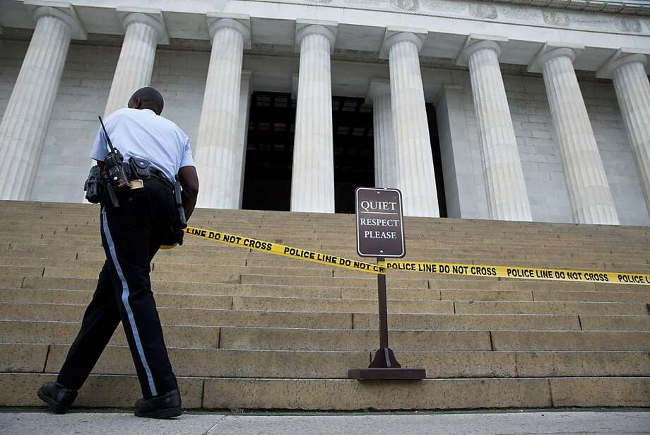 A member of the Park Police places police tape in front of the Lincoln Memorial due to a partial government shut down in Washington, D.C., U.S. on Tuesday, Oct. 1, 2013. The U.S. government began its first partial shutdown in 17 years, idling as many as 800,000 federal employees, closing national parks and halting some services after Congress failed to break a partisan deadlock by a midnight deadline. Photo: Joshua Roberts, Bloomberg
