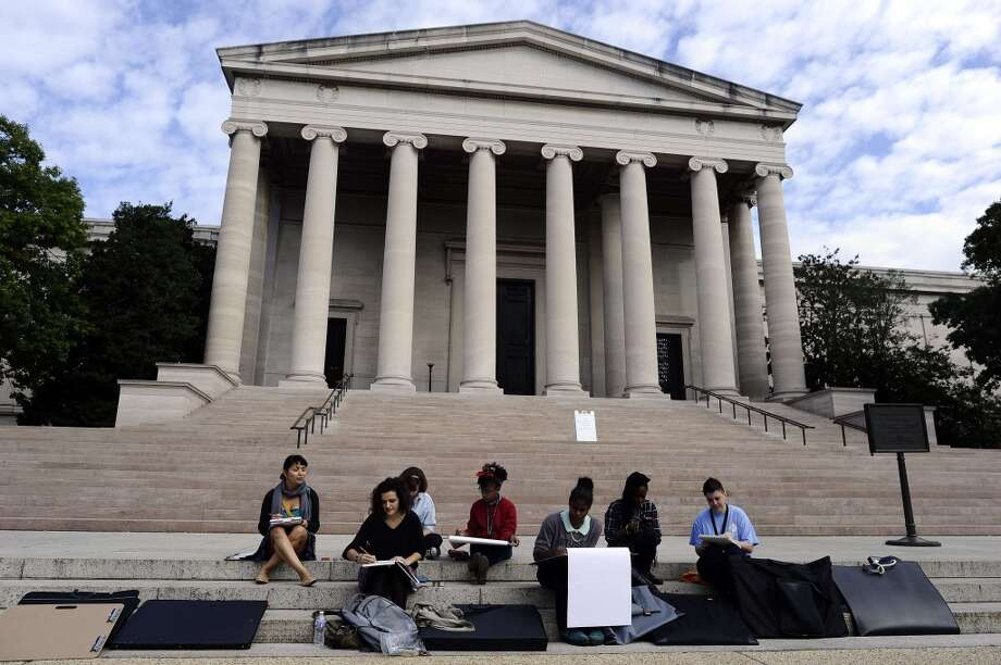 A group of art students take up the staircase of the National Art Gallery as it is closed due to Federal government shutdown in Washington, DC, on October 1, 2013. Photo: JEWEL SAMAD, AFP/Getty Images