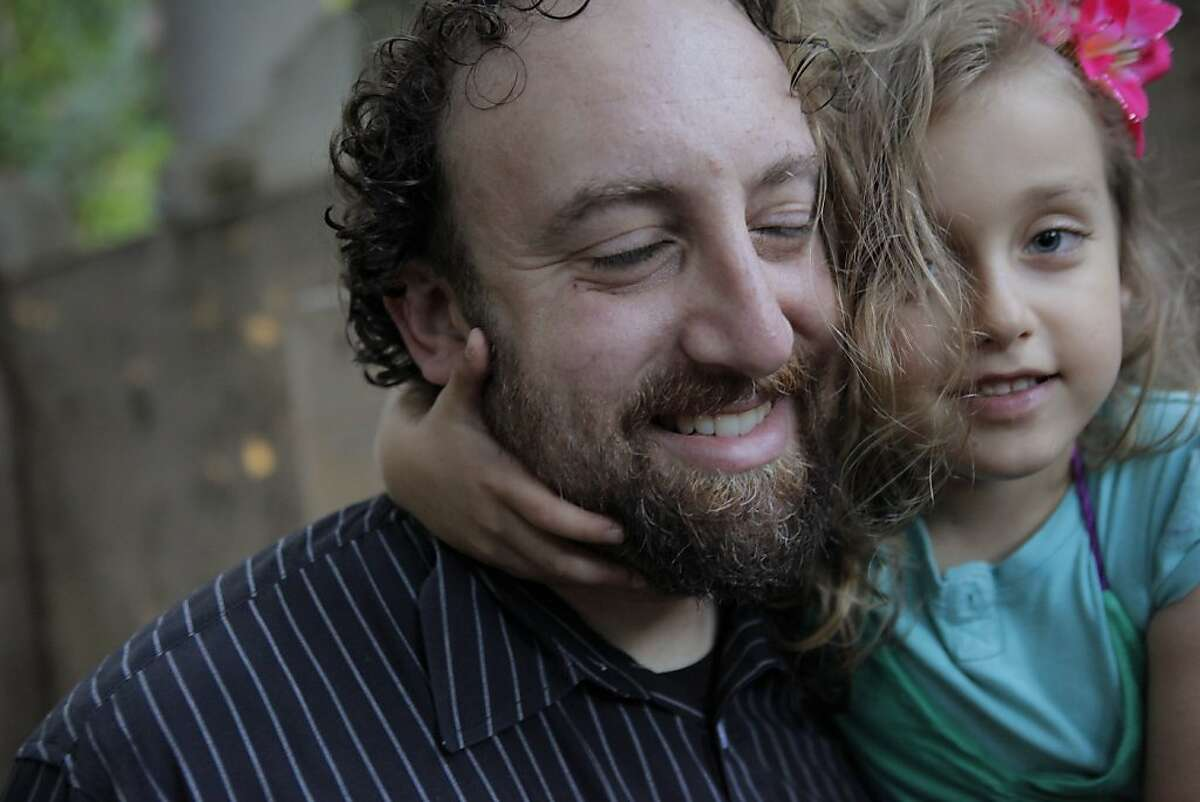 Joshua Safran with his daughter Sivan, 6, at their Oakland, Calif., home on Sunday, August 18, 2013. Safran has written a memoir about growing up off the grid with his free spirit mother - living in the woods, in buses, in half-finished cabins as she goes through a string of abusive relationships looking for counterculture utopia. Safran, an Oakland attorney most known for his pro-bono work to free a woman imprisoned for her abusive boyfriend's murder, reveals in his book Free Spirit why he is so passionate about helping battered women.