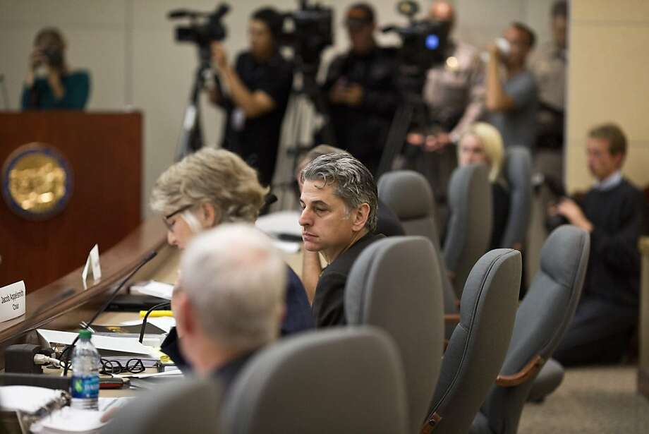 "Jacob Appelsmith (center) oversees the August hearing in Oakland on the contract dispute between BART and labor. As the governor's ""cooling-off period"" winds down, a strike threat looms. Photo: Jason Henry, New York Times"