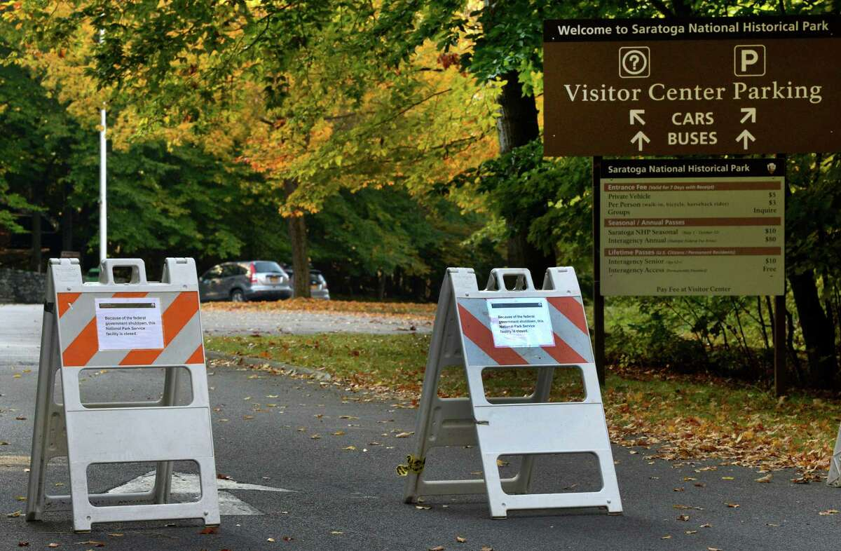 Signs at the Visitors Center entrance of Saratoga National Historical Park note the park's closing due to the federal shutdown Tuesday, Oct. 1, 2013, in Stillwater, N.Y.