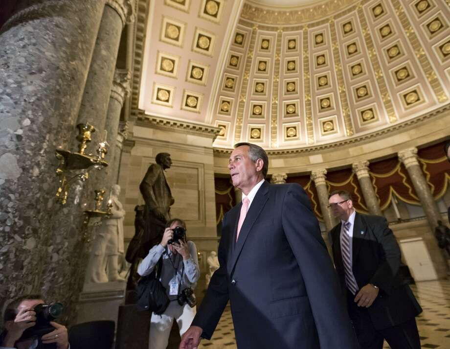 "Speaker of the House John Boehner, R-Ohio, walks to the House floor as Congress' Republican-run lower chamber refuses to pass a ""clean"" budget bill and shuts down the government.  Photo: J. Scott Applewhite, Associated Press"