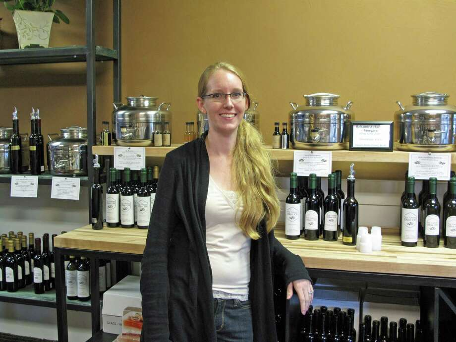 "Heidi Burrows is the owner of the New Canaan Olive Oil store at 98 Elm Street. ""I'm obsessed with olive oil,"" she said. Photo: Tyler Woods"