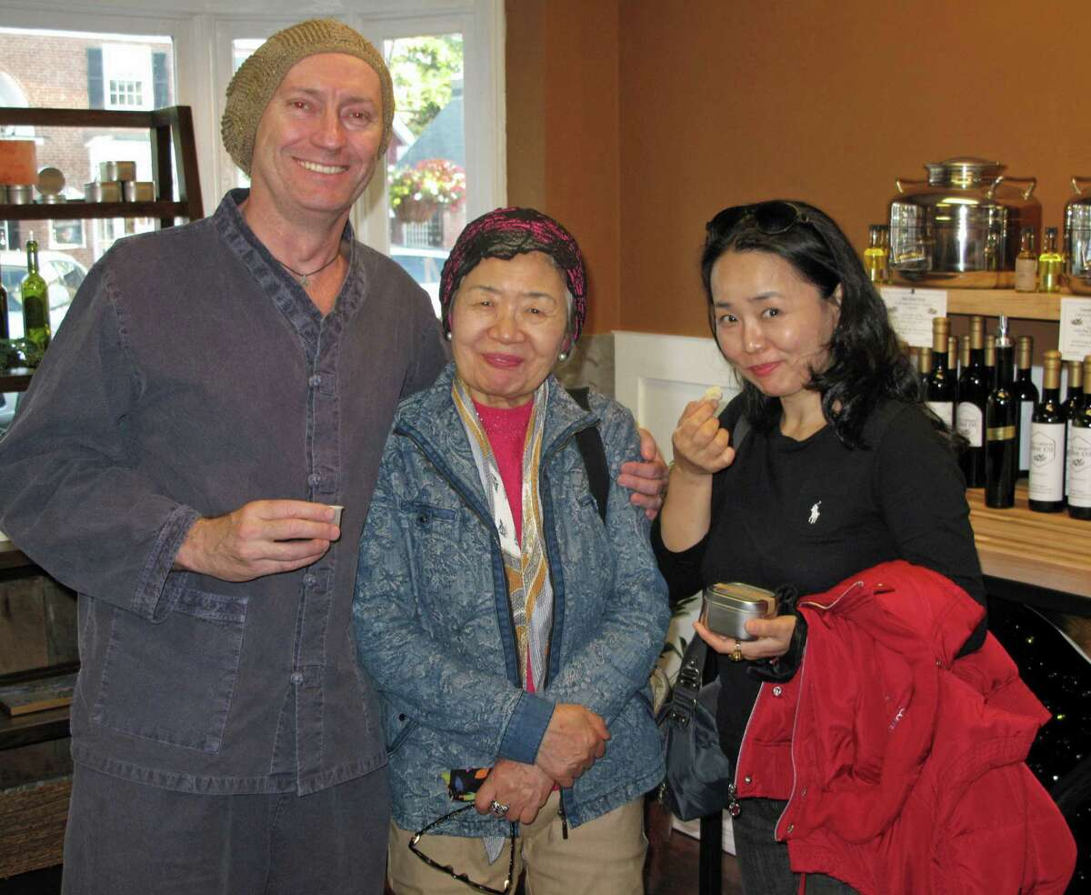 Jamie Jackson, Mrs. Kim, and SoHee Youn visit the New Canaan Olive Oil store. The group was visiting from New York City. The store, at 98 Elm Street, will have a grand opening Oct. 5 from 3 p.m. to 7 p.m.