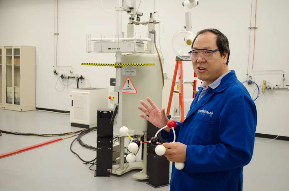 Xueyong Yang describes the process of using NMR to see the individual atoms of a chemical sample during the opening of LyondellBasell's Houston Technology Center. Photo: Jamaal Ellis, For The Chronicle