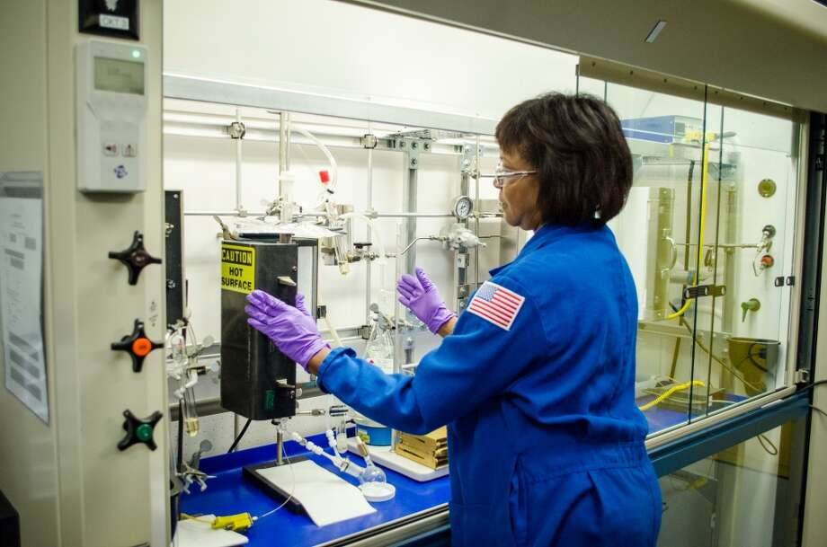 Debra Jackson monitors a recently synthesized catalyst during the opening of LyondellBasell's Houston Technology Center. Photo: Jamaal Ellis, For The Chronicle