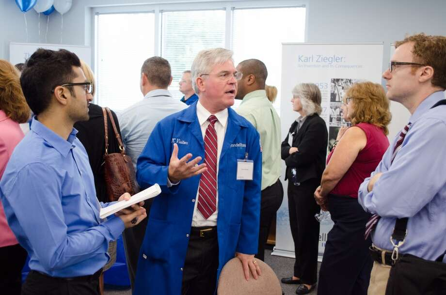 David Harpole (center) answers questions during the opening of LyondellBasell's 70,000-square-foot Houston Technology Center on September 30, 2013 in Channelview, TX. Photo: Jamaal Ellis, For The Chronicle