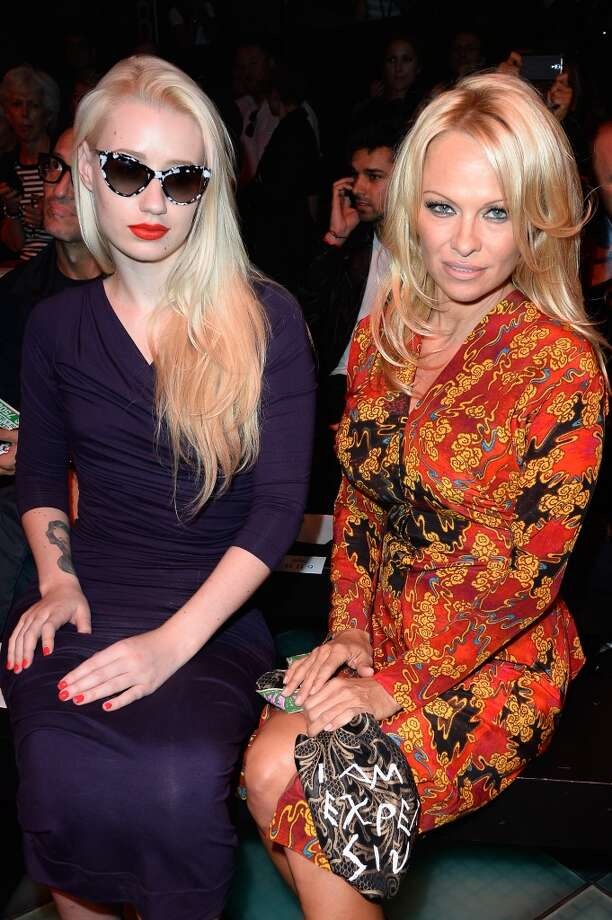 Iggy Azalea and Pamela Anderson attend the Vivienne Westwood show as part of the Paris Fashion Week Womenswear  Spring/Summer 2014 at Le Centorial on September 28, 2013 in Paris, France.  (Photo by Pascal Le Segretain/Getty Images) Photo: Pascal Le Segretain, Getty Images