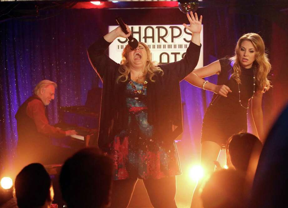 "This image released by ABC shows Rebel Wilson, center, and Kate Jenkinson in a scene from ""Super Fun Night,"" premiering Wednesday, Oct. 2, at 9:30 p.m. EST on ABC. (AP Photo/ABC, Gilles Mingasson) ORG XMIT: NYET202 Photo: Gilles Mingasson / American Broadcasting Companies, Inc."