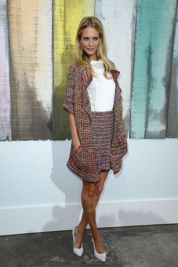 Poppy Delevingne attends the Chanel show as part of the Paris Fashion Week Womenswear  Spring/Summer 2014 at Grand Palais on October 1, 2013 in Paris, France.  (Photo by Pascal Le Segretain/Getty Images) Photo: Pascal Le Segretain, Getty Images