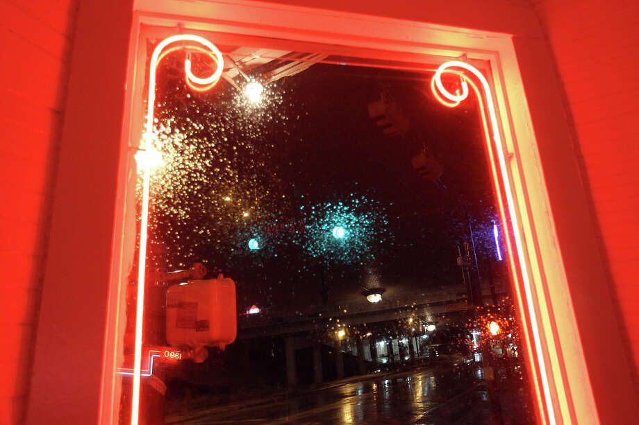 Rain reflected the colors of the neon on the windows on the last night of the old leaning Liberty Bar in 2010. Photo: Jennifer Whitney, Special To The Express-News / spoecial to the San Antonio Express-News