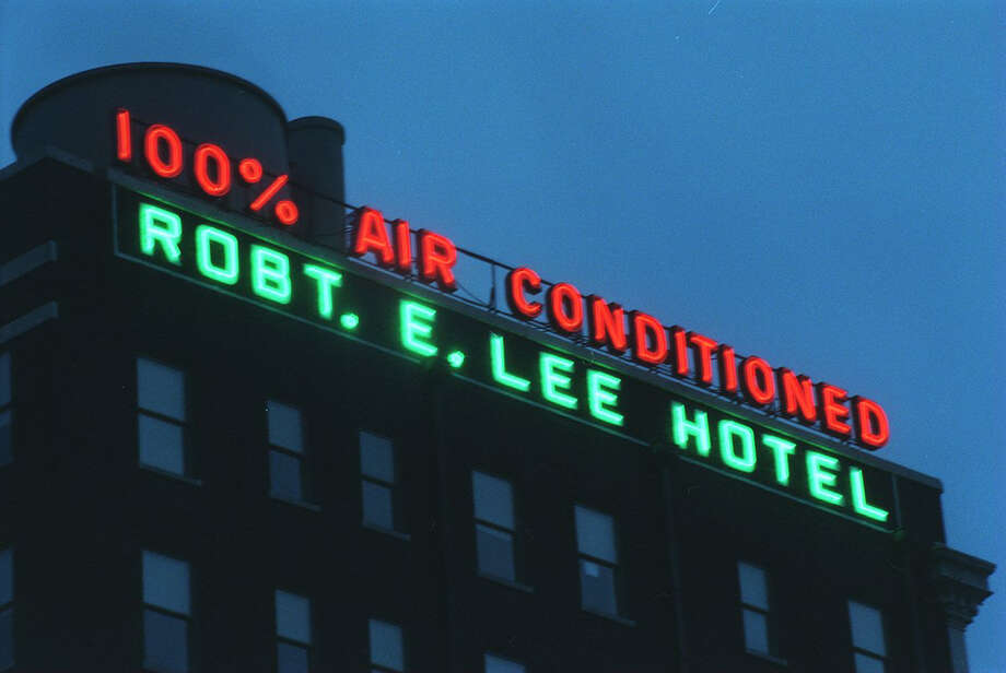 San Antonio visitors are very familiar with this downtown hotel's neon sign. Photo: Morris Goen, EXPRESS-NEWS FILE PHOTO / SAN ANTONIO EXPRESS-NEWS