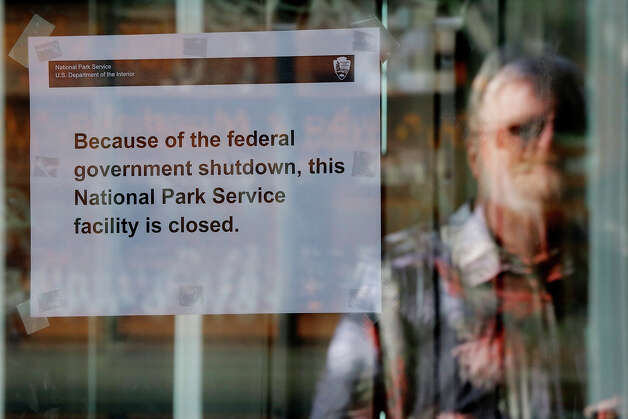 Karl Engdahl, of Walnut Creek, Calif., is seen reflected in the closed entrance to the Liberty Bell at Independence National Historical Park in Philadelphia. Photo: Matt Rourke, ASSOCIATED PRESS / AP2013