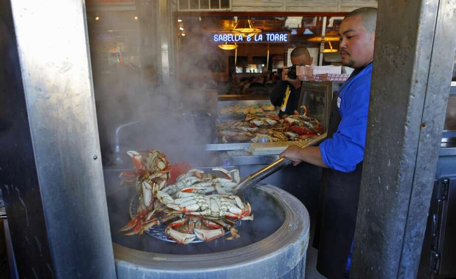 Carlo Chavez at the Sabella & La Torre crab shack,  cooks and cleans crabs. Photo: Lacy Atkins, The Chronicle