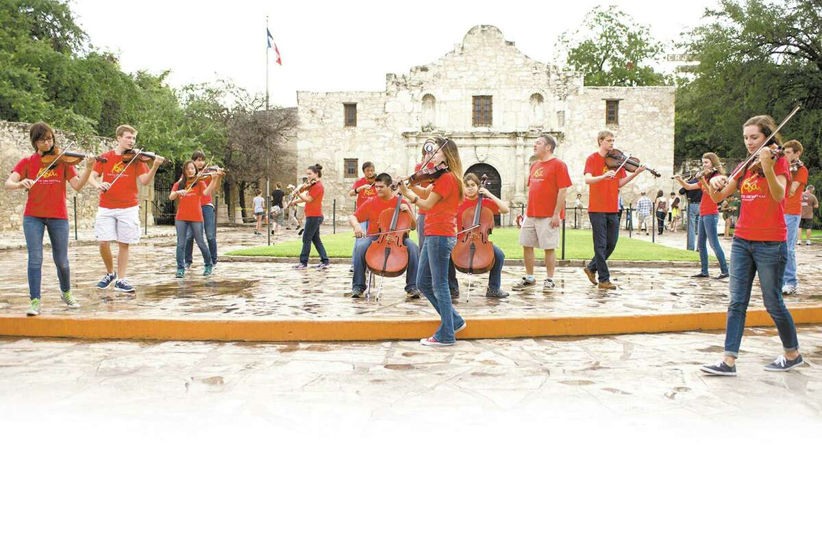 """Members of Youth Orchestras of San Antonio's Pop Up Orchestra play in Alamo Plaza during Sícolovía. The """"pop up"""" performances feature a more contemporary sound and will be a part of a YOSA fundraiser Saturday."""