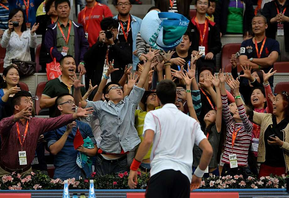 Who wants Novak Djokovic's sweaty towel?Just about everyone in the front rows of China Open in Beijing.   Djokovic had just dispatched Lukas Rosol, 6-0, 6-3. Photo: Mark Ralston, AFP/Getty Images