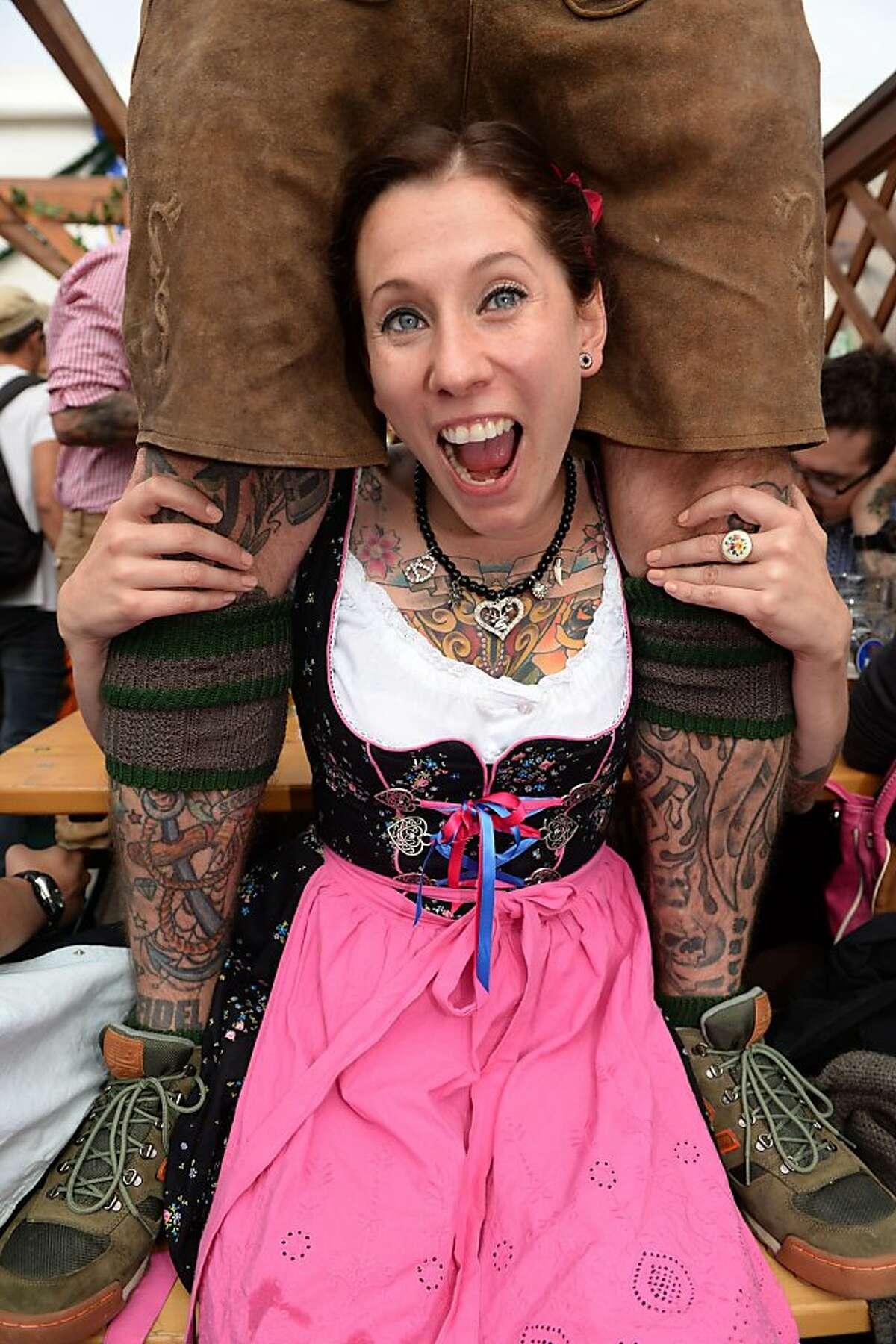 Follow the lederhosen : A tattooed couple celebrate Oktoberfest in Munich.