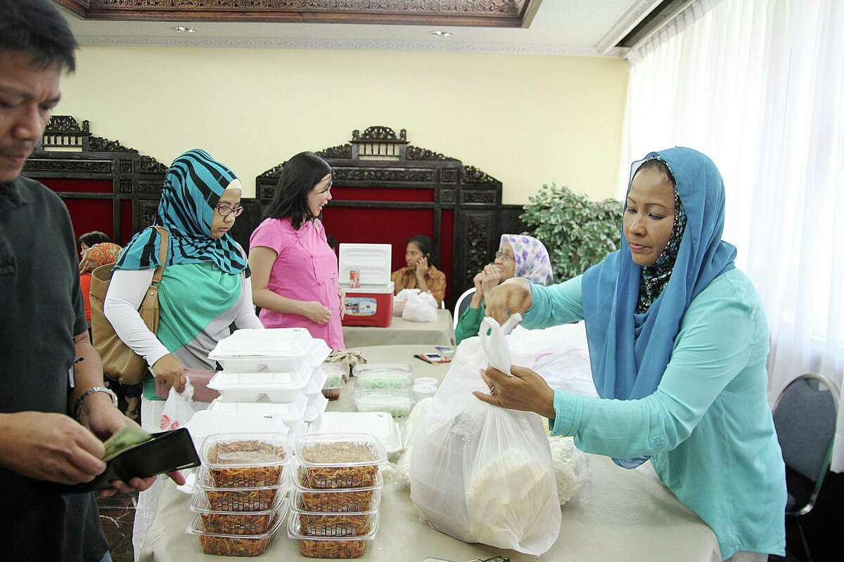 Titi Areis sells some of her specialty home-cooked Indonesian food at the food fair offered Saturdays at the Consulate General of the Republic of Indonesia.
