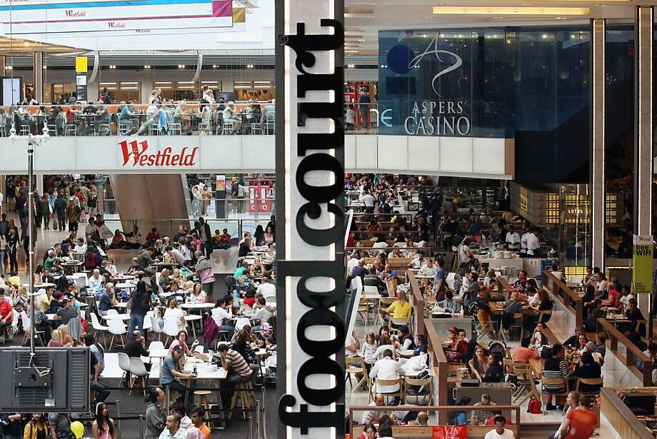 Members of the public dine in the food court of the giant Westfield Stratford shopping mall adjacent to the Olympic Park in London. Photo: Oli Scarff, Getty Images