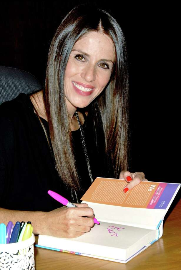 """Actress and author Soleil Moon Frye signs copies of her book """"Happy Chaos: From Punky To Parenting And My Perfectly Imperfect Adventures In Between"""" at a bookstore in Los Angeles in 2011. She will be in Darien, Conn., on Wednesday, Oct. 16, 2013, to sign copies of her latest book, """"Let's Get This Party Started."""" Frye gained superstar status in the 1980s for her role as Punky Brewster in a sitcom of the same name. Since that early start, she has branched out to directing, writing books and launching new businesses. To RSVP, email barrettbooks@sbcglobal.net or call 203-655-2712. Photo: Contributed Photo / Stamford Advocate Contributed"""