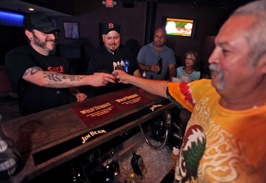 From left, Lee Pelly, Aaron Hagen and Joe Garcia toast a shot during the PaceSetter's Sunday Funday.  Guiseppe Barranco/The Enterprise Photo: Guiseppe Barranco/The Enterprise