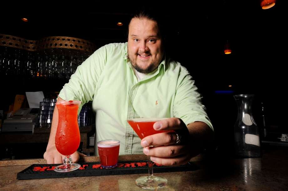 Bartender Sam Gregory at Pacesetter Lounge in Beaumont is a finalist in the cat5 drink competition. His creation is a delicious spelling of cat5: C-Cointreau, A- Amaretto, T-Tuaca and 5-Mixers: 1-Pineapple Juice, 2-Sweet and Sour, 3- Cranberry Juice, 4-Roses Lime Juice, 5-Sierra Mist. Thursday, September 29, 2011 Valentino Mauricio/The Enterprise Photo: Valentino Mauricio/The Enterpris