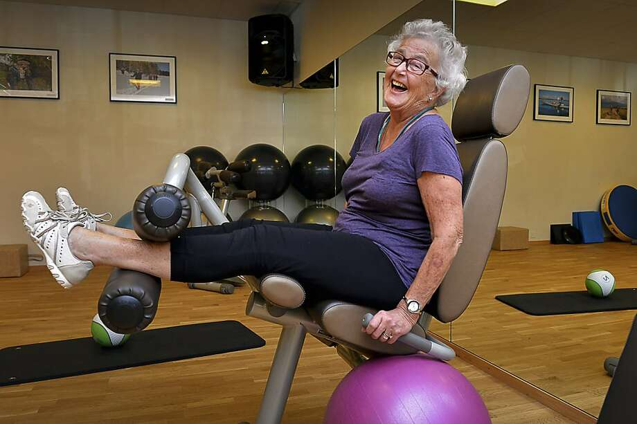 Marianne Blomberg, 80, works out at a gym in Stockholm. Being physically fit helps to minimize and even reverse a loss of strength, key to keeping young, and feeling young, inside and out. Photo: Jonas Ekstromer, Associated Press
