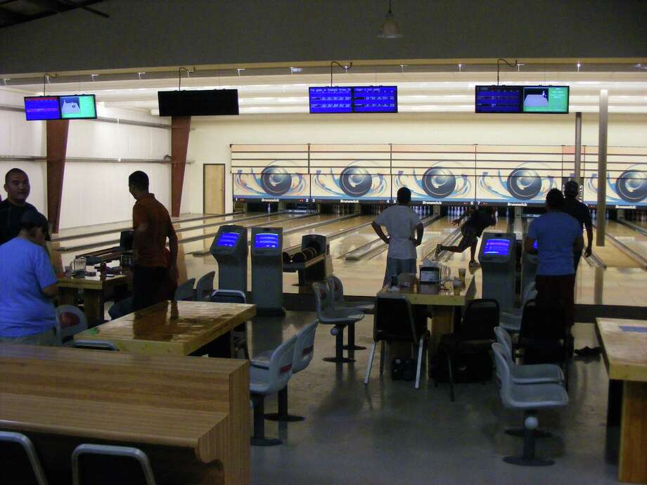 A look inside the Turner Bowling Club in Kirby reveals 16 lanes of state-of-the-art 10-pin bowling for its 350 members. Photo: Jeff B. Flinn / NE Herald