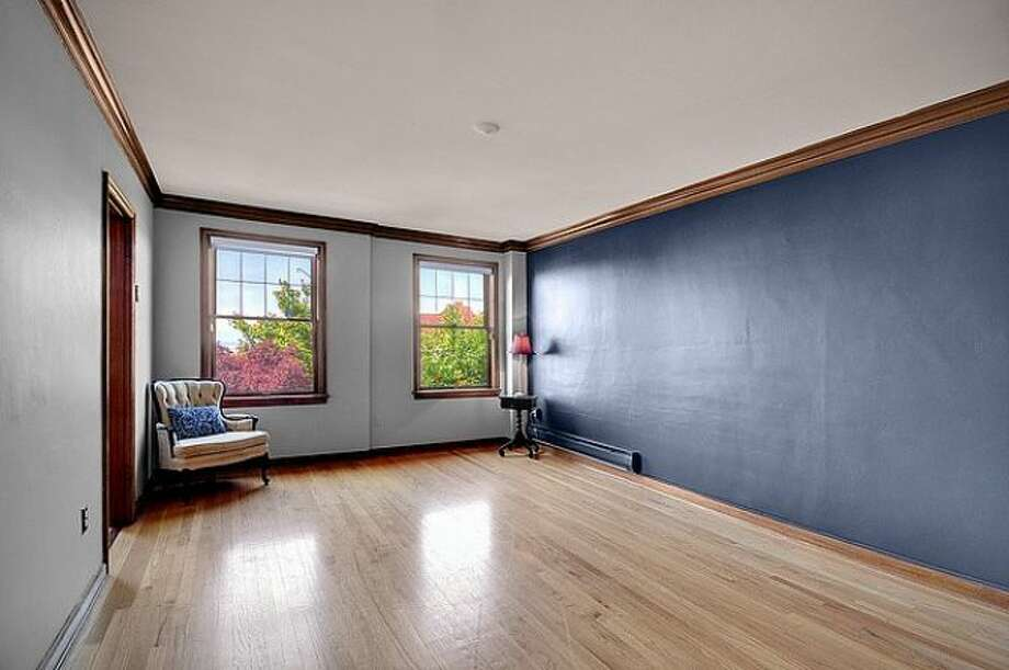 Next comes 400 Boylston Ave. E., No. 310. The 511-square-foot condo has one bedroom, one bathroom, mahogany millwork, crown molding, wood, tile and cork floors, and a view of the Space Needle in a 1931 courtyard building. It's listed for $237,500. Photo: Courtesy Casey Price, Windermere Real Estate
