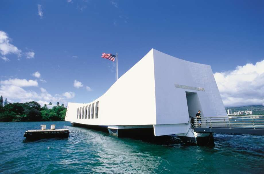 The USS Arizona Memorial, which  straddles the hull of the sunken battleship and commemorates the 1941 Japanese attack on Pearl Harbor, is one of the most popular visitor destinations in Hawai'i. Photo: Kirk Lee Aeder, HTA