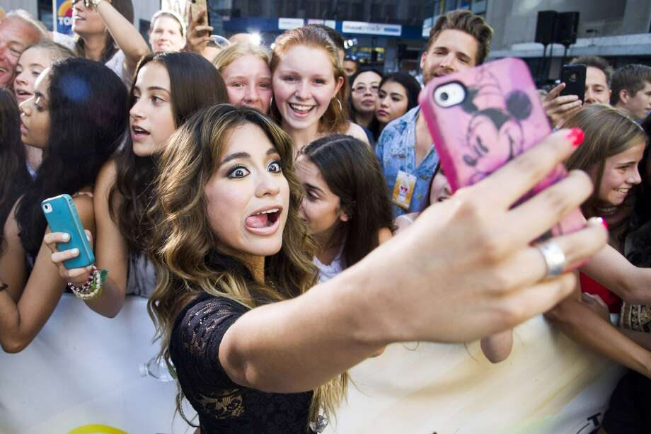 "Ally Brooke snaps a selfie with fans at the ""Today"" show. (AP) Photo: Charles Sykes, Associated Press"