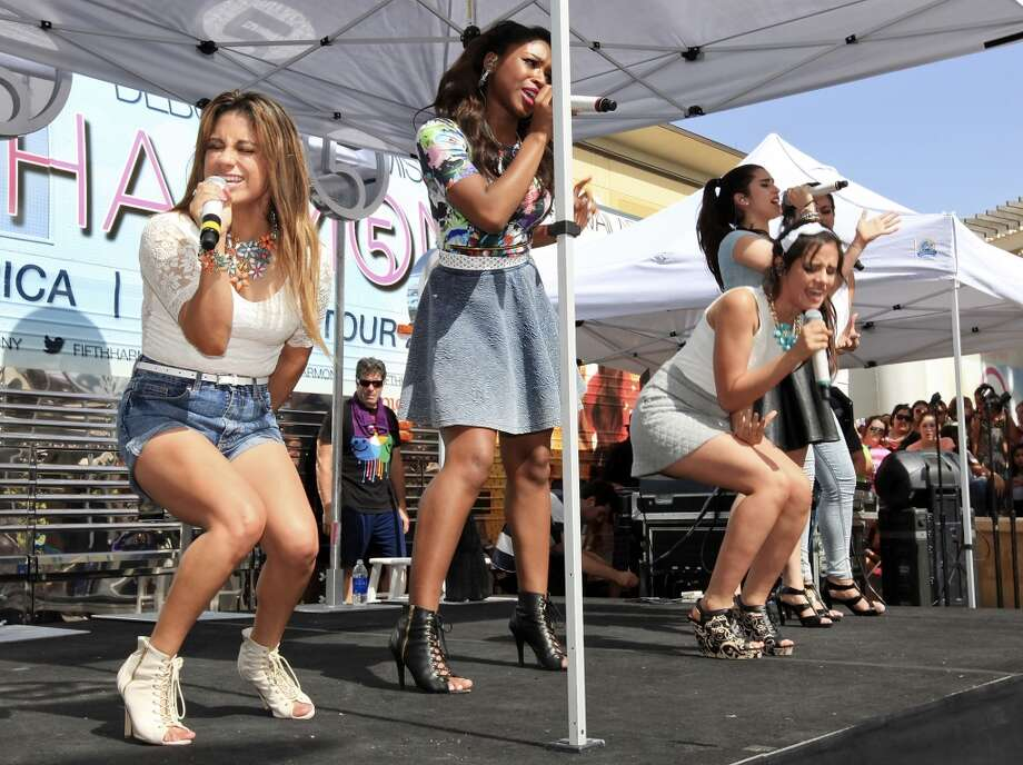 Ally Brooke (left) sings for hometown fans during a Fifth Harmony appearance at The Shops at La Cantera. (Edward A. Ornelas) Photo: Edward A. Ornelas, San Antonio Express-News